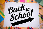 Composite image of back to school message with arrow — Foto Stock