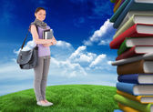 Student holding books and bag — Stock Photo