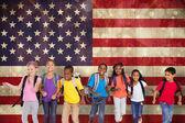 Pupils running against usa flag — Stock Photo