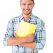 Handsome student holding notepad smiling at camera — Stock Photo #51591979