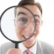 Excited businessman looking through magnifying glass — Stock Photo #51593241