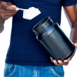 Man holding a scoop of protein mix — Stock Photo #51593799