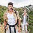 Couple walking on mountain terrain — Stock Photo #51595125