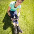 Fit mature woman in roller blades on the grass — Stock Photo #51595187