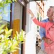 Happy senior couple shopping and pointing in the city — Stock Photo #51595731