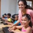 Pupils in computer class with teacher — Stock Photo #51595959
