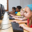 Cute pupils in computer class — Stock Photo #51596181