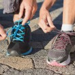 Couple tying their laces of running shoes — Stock Photo #51596741