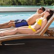 Couple resting on sun loungers — Stock Photo #51597287