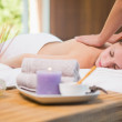 Attractive woman receiving back massage at spa center — Stock Photo #51597525