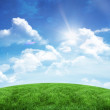Green hill under blue sky — Stock Photo #51598457