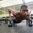 Man doing push ups with kettle bells — Stock Photo #51598657
