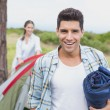 Couple with tent walking on countryside landscape — Stock Photo #51598749