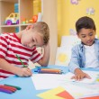 Little boys drawing at desk — Stock Photo #51599299