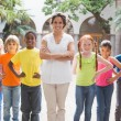 Teacher standing with pupils in courtyard — Stock Photo #51599405