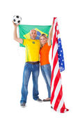 Football fan couple cheering and smiling at camera — Photo