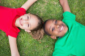 Cute children outside on the grass — Stock Photo