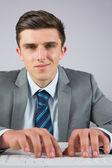 Businessman sitting at desk typing — Foto de Stock