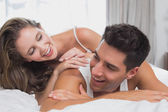 Romantic young couple in bed at home — Stock Photo