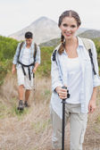 Hiking couple walking on countryside landscape — Stockfoto