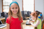 Pupil in computer class smiling — Stock Photo