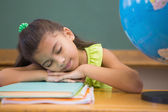 Pupil napping in classroom with globe — Stock Photo