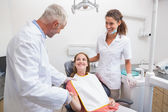 Dentist shaking hands with his patient in the chair — Stock Photo