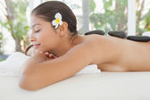 Brunette relaxing on massage table — Stock Photo