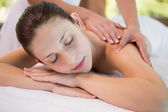 Attractive woman receiving back massage at spa center — Stock Photo