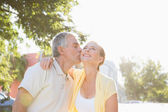 Happy senior couple embracing in the city — Stock Photo