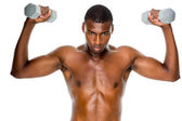 Determined fit man lifting dumbbells — Stok fotoğraf