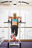 Rear view of fit woman doing crossfit fitness workout gym — Stock Photo