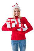 Festive blonde holding many presents — Stockfoto