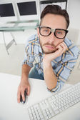 Nerdy bored businessman working on computer — Stock Photo