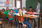 Pupils smiling in classroom — Stock Photo