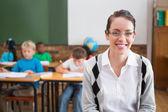 Teacher smiling at top of classroom — Foto de Stock