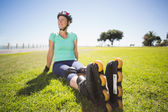 Fit mature woman in roller blades on the grass — Stock Photo