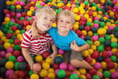 Children playing in ball pool — Stock Photo
