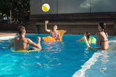 People playing in swimming pool — Stock Photo
