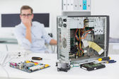 Computer engineer looking at broken console — Stock Photo