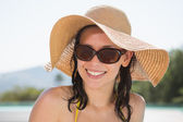 Close up portrait of cheerful woman wearing hat — Stock Photo