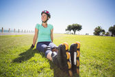 Fit mature woman in roller blades on the grass — Foto de Stock