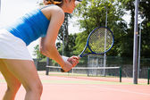Tennis player standing on court — Stock Photo