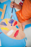 Little boy painting at table in classroom — Stock Photo
