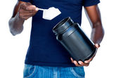 Man holding a scoop of protein mix — Stock Photo