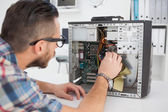 Computer engineer working on broken console — Foto Stock
