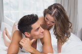 Romantic young couple in bed at home — Stockfoto