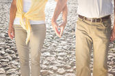 Happy senior couple touching hands — Stock Photo