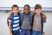 Classmates smiling in classroom — Stock Photo