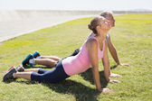 Fit mature couple warming up on the grass — Stock Photo